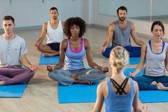 Instructor taking yoga class Royalty Free Stock Photography