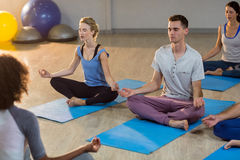 Instructor taking yoga class Royalty Free Stock Image
