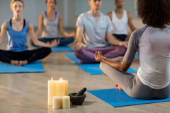 Instructor taking yoga class Stock Photography
