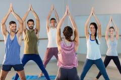 Instructor taking yoga class Stock Photo