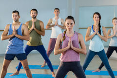 Instructor taking yoga class Royalty Free Stock Photo