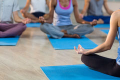 Instructor taking yoga class Royalty Free Stock Images