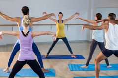 Instructor taking yoga class Royalty Free Stock Photos