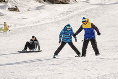 The instructor teaches how to ski on snow downhill ski training on the resort Dombay Royalty Free Stock Photography