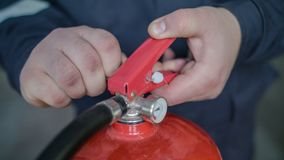 Instructor teaches the use of a fire extinguisher, close up royalty free stock images