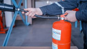 Instructor teaches the use of a fire extinguisher royalty free stock image