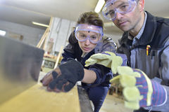 Instructor teaching apprentice carpentry Stock Photos