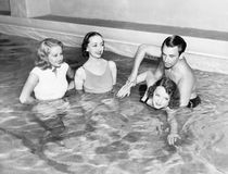 Instructor teaching women how to swim royalty free stock photos