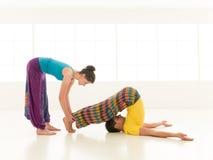 Instructor teaching yoga Stock Photography