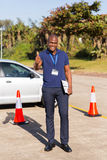 Instructor thumb up. Happy driving instructor in testing ground giving thumb up Royalty Free Stock Image