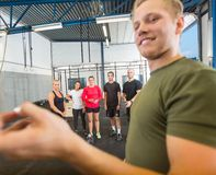 Instructor Training Athletes At Gym Royalty Free Stock Images