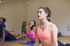 Instructor With Yoga Class At Gym Royalty Free Stock Image