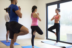 Instructor With Yoga Class At Gym Stock Images