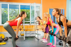 Instructor, young women exercising with dumbbells Royalty Free Stock Photography
