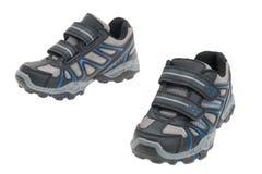 Instructores o zapatillas deportivas de los muchachos Imagen de archivo libre de regalías
