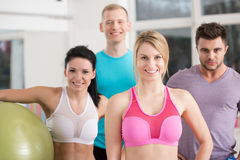 Instructors in fitness club. Group of fit instructors in fitness club Royalty Free Stock Photos