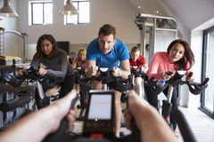 Instructors POV of spinning class at a gym Stock Photos