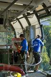 Instructors prepare the equipment for jumping  in the SKYPARK AJ. SOCHI, RUSSIA, SEPTEMBER 24, 2016 Instructors prepare the equipment for jumping  in the SKYPARK Royalty Free Stock Photo