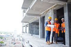 Instructors at work. Group of instructors talking on construction site Royalty Free Stock Image