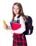 Instruisez l'enfant de fille avec des fournitures scolaires d'isolement sur le blanc Photographie stock libre de droits