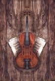 Instrument de musique de violon de violon de vintage d'aquarelle avec des notes de musique sur le fond en bois de texture Image libre de droits