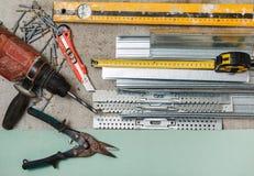 Instrument för byggande väggar för en gipsplatta arkivfoton