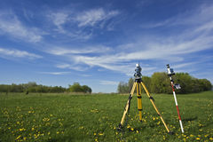Instrument in the field. Spring land surveying stock images