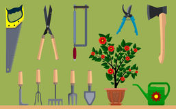 Instrument for gardening flowerpot watering can ax and saw. Eps10  illustration Stock Image