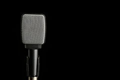 Instrument Microphone on Black Background. A microphone used to amplify instruments is photographed on a black background stock photo