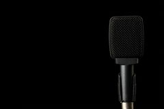 Instrument Microphone on Black Background. A microphone used to amplify instruments is photographed on a black background stock photos