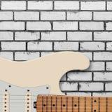 Instrument muzyczny - sylwetki gitary elektrycznej ściana z cegieł Obraz Royalty Free