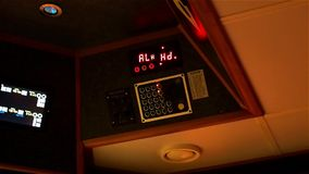 Instrument panel of ship in twilight, in lamplight. Close-up. stock video footage