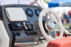 Instrument panel and steering wheel of a motor boat cockpit yacht control bridge. stock photos