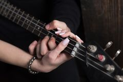 Instrumental music live. Couple in love play duets. Male and female hands play the electric guitar. Couple of guitar. Players. Couple of musicians enjoy playing royalty free stock images