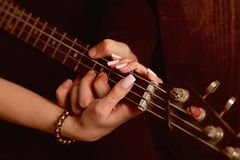 Instrumental music live. Couple in love play duets. Male and female hands play the electric guitar. Couple of guitar. Players. Couple of musicians enjoy playing stock photography