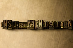 INSTRUMENTATION - close-up of grungy vintage typeset word on metal backdrop Stock Photo
