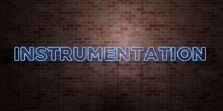 INSTRUMENTATION - fluorescent Neon tube Sign on brickwork - Front view - 3D rendered royalty free stock picture Stock Image