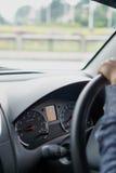 Instrumentbräda och chaufför Fotografering för Bildbyråer