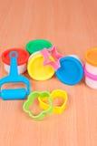 Instrumente für das Spielen mit Formteilteig Stockbild