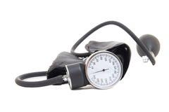 Instrumento de la medida de la presión arterial aislado en blanco fotografía de archivo libre de regalías