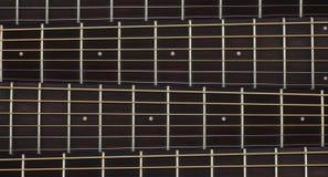 Instrumento musical - fundo do pescoço da guitarra acústica fotografia de stock royalty free