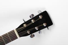 Instrumento musical - guitarra acústica preta do headstock imagem de stock royalty free