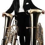 Instrumentos de bronze do jogador da tuba fotografia de stock royalty free