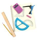 Instrumentos de la matemáticas y libreta espiral fotografía de archivo
