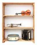 Instrumentos de música en estante Imagen de archivo
