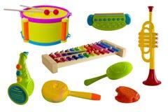 Instrumentos musicais, grupo em um fundo isolado, crianças Cilindro, trombeta, saxofone, xilofone, harmônica, castanholas Fotos de Stock