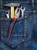 Instruments in a back pocket of a jeans Stock Photo