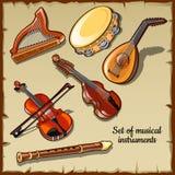 Instruments de musique de ficelle et de vent, six icônes Photos stock