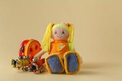 Instruments de musique et poupée Image stock