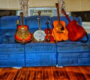 Instruments lined up on a couch